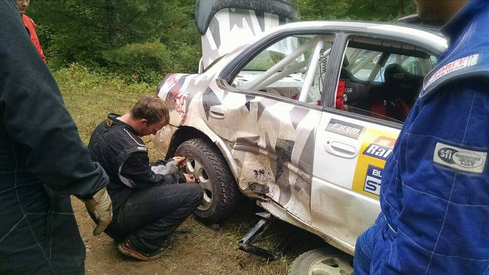 Inspecting Rally Car Damage